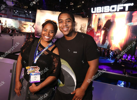 Shar Jackson, left, and Christopher Massey visit the Ubisoft booth at E3, at the Los Angeles Convention Center
