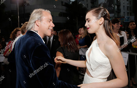 """Director Harald Zwart and Lily Collins arrive on the red carpet at the world premiere of """"The Mortal Instruments: City of Bones"""" at the ArcLight Cinerama Dome on in Los Angeles"""