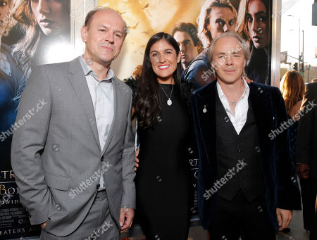 """Producer Robert Kulzer, Screenplay writer Jessica Postigo Paquette and Director Harald Zwart arrive on the red carpet at the world premiere of """"The Mortal Instruments: City of Bones"""" at the ArcLight Cinerama Dome on in Los Angeles"""