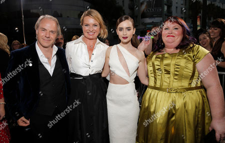 """Director Harald Zwart, Ceslemoy Rudd Zwart, Lily Collins and Author Cassandra Clare arrive on the red carpet at the world premiere of """"The Mortal Instruments: City of Bones"""" at the ArcLight Cinerama Dome on in Los Angeles"""