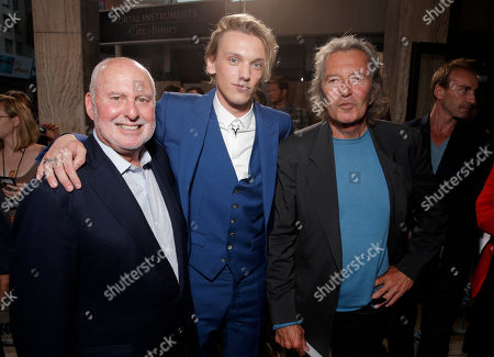 "Executive Producer Michael Lynne, Jamie Campbell Bower and Executive Producer Bob Shaye arrive on the red carpet at the world premiere of ""The Mortal Instruments: City of Bones"" at the ArcLight Cinerama Dome on in Los Angeles"