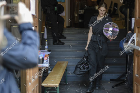 An activist carries a disco ball as she leaves voluntarily the Volksbuehne theater (People's Theater) on Rosa-Luxemburg-Platz in Berlin, Germany, 28 September 2017. As a 'trans-media performance' and an act of protest against the new direction of the traditional theater, a group of people have been occupying the building since 22 September 2017. The new director, Belgian Chris Dercon, let the theater clear by police on 28 September 2017.