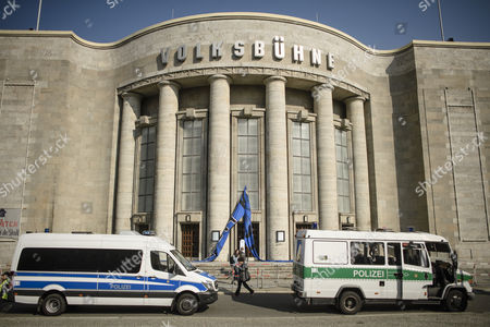Police cars stand in front of the occupied Volksbuehne theater (People's Theater) on Rosa-Luxemburg-Platz in Berlin, Germany, 28 September 2017. As a 'trans-media performance' and an act of protest against the new direction of the traditional theater, a group of people have been occupying the building since 22 September 2017. The new director, Belgian Chris Dercon, let the theater clear by police on 28 September 2017.