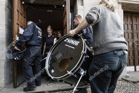 Activists carry parts of a drum set as they leave voluntarily the Volksbuehne theater (People's Theater) on Rosa-Luxemburg-Platz in Berlin, Germany, 28 September 2017. As a 'trans-media performance' and an act of protest against the new direction of the traditional theater, a group of people have been occupying the building since 22 September 2017. The new director, Belgian Chris Dercon, let the theater clear by police on 28 September 2017.