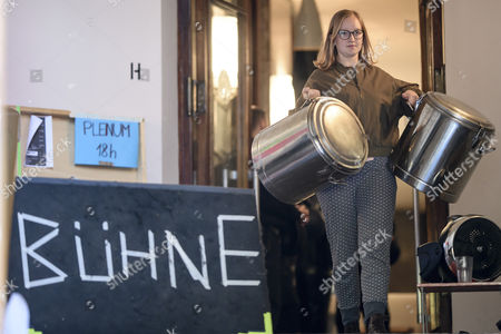 An activist carries canisters as she leaves voluntarily the Volksbuehne theater (People's Theater) on Rosa-Luxemburg-Platz in Berlin, Germany, 28 September 2017. As a 'trans-media performance' and an act of protest against the new direction of the traditional theater, a group of people have been occupying the building since 22 September 2017. The new director, Belgian Chris Dercon, let the theater clear by police on 28 September 2017.