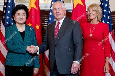 Rex Tillerson, Betsy DeVos, Liu Yandong. Secretary of State Rex Tillerson, accompanied by Education Secretary Betsy DeVos, right, welcomes Chinese Vice Premier Liu Yandong during a working breakfast at the State Department, in Washington