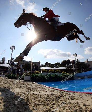 Elizabeth Madden of USA riding Darry Lour clears the water jump in the first qualifying round of the Longines FEI Nations Cup jumping competition in Barcelona, Spain, 28 September 2017.