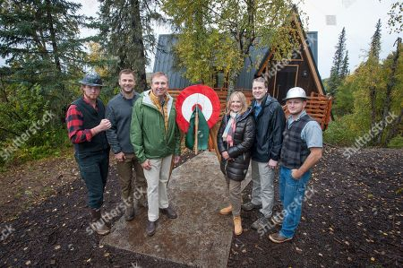 """From left to right) Lumberjack Boone Scheer, Animal Planet's Dave Salmoni, Senior Vice President, Licensing & Global Location Based Entertainment at Discovery Communications Robert Marick, Princess Cruises Vice President of Alaska Product Management Lisa Syme, Lodge General Manager Richard Peterson and Lumberjack Bryce Smith celebrated the grand opening of the Mt. McKinley Princess Wilderness Lodge Treehouse, a project developed in collaboration with Animal Planet's hit show, """"Treehouse Masters"""