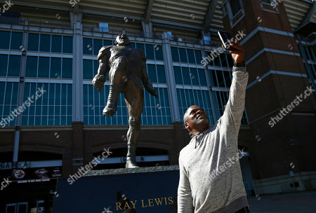 Ray Lewis, Leonard Key. Baltimore Ravens fan Leonard Key takes a selfie in front of a statue depicting former Ravens linebacker Ray Lewis outside M&T Bank Stadium in Baltimore