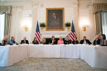 """Tom Price, Melania Trump, Rebecca Crowder, Linda Davis, Debbie taylor, Chris Christie, Kellyanne Conway, Daniel Goonan. From third from left, Secretary of Health and Human Services Tom Price, Macomb County District Judge Linda Davis, Rebecca Crowder of """"Lily's Place,"""" first lady Melania Trump, Counselor to President Donald Trump Kellyanne Conway, Goonan N.H. Fire Chief Daniel Goonan, Debbie Taylor, New Jersey Gov. Chris Christie, and others attend an opioid roundtable discussion at the White House in Washington, . Melania Trump invited experts and people affected by addiction to opioids to the White House for a listening session and discussion about the epidemic"""