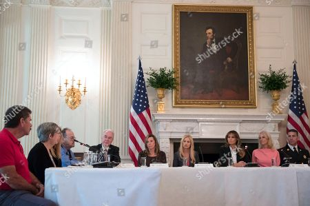 """Tom Price, Melania Trump, Rebecca Crowder, Linda Davis, Kellyanne Conway, Daniel Goonan. From fifth from left, Secretary of Health and Human Services Tom Price, Macomb County District Judge Linda Davis, Rebecca Crowder of """"Lily's Place,"""" first lady Melania Trump, Counselor to President Donald Trump Kellyanne Conway, and Goonan N.H. Fire Chief Daniel Goonan, attend an opioid roundtable discussion at the White House in Washington, . Melania Trump invited experts and people affected by addiction to opioids to the White House for a listening session and discussion about the epidemic"""