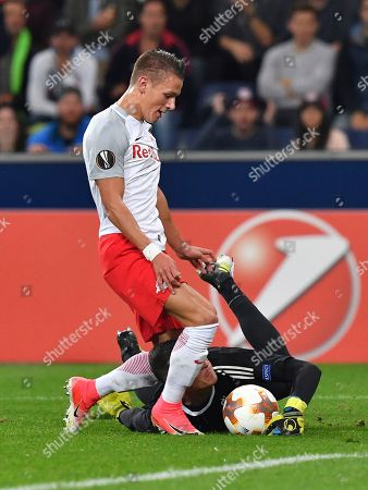 Salzburg's Hannes Wolf, left, and Marseille's Yohann Pele challenge for the ball during the Europa League group I soccer match between FC Salzburg and Olympique Marseille in the Arena in Salzburg, Austria