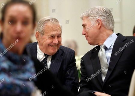 Neil Gorsuch, Donald Rumsfeld. Former Defense Secretary Donald Rumsfeld, left, smiles as talks with Supreme Court Justice Neil Gorsuch, right, at the 50th anniversary of the Fund for America Studies luncheon at the Trump Hotel in Washington