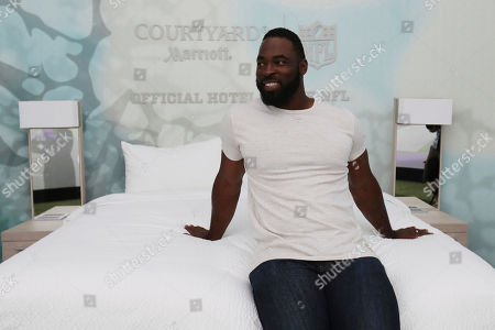 """NFL star Justin Tuck helps promote Courtyard's """"Super Bowl Sleepover Contest"""" by showcasing a custom 4-D Virtual Reality dome that simulates the prize experience of being on a field at this year's Super Bowl on in New York"""
