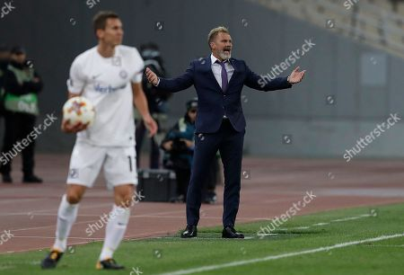 Austria's head coach Thorsten Fink, reacts during the Europe League Group D soccer match between AEK Athens' and Austria Vienna's at Olympic Stadium of Athens