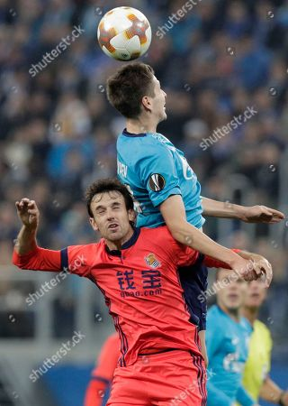 Daler Kuzyayev, Ruben Pardo. Zenit's Daler Kuzyayev, top, and Real Sociedad's Ruben Pardo fight to head the ball during a Europa League, Group L, soccer match between Zenit St. Petersburg and Real Sociedad in St. Petersburg, Russia