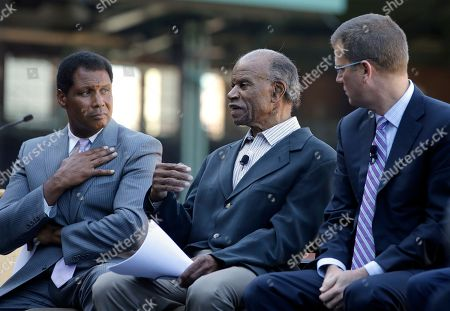 """Steve Burton, Tommy Harper, Sam Kennedy. Moderator Steve Burton, WBZ-TV sports director, left, Boston Red Sox Hall of Famer Tommy Harper, center, and Red Sox President and CEO Sam Kennedy, right, participate in a panel discussion held to introduce an initiative called """"Take The Lead,"""", at Fenway Park in Boston. The Red Sox, Patriots, Celtics, Bruins, and Revolution are joining the project that was unveiled Thursday"""
