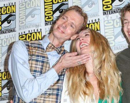 """Doug Jones, left, and Sarah Carter attend the """"Falling Skies"""" press line on day 2 of Comic-Con International, in San Diego"""