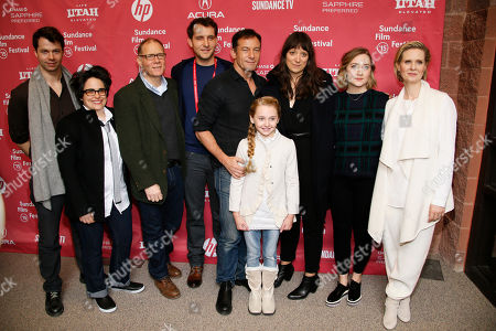 "From left to right, composer Brian McOmber, composer Nora Kroll-Rosenbaum, actor David Warshofsky, producer Greg Ammon, actor Jason Isaacs, actress Avery Phillips, director and screenwriter Nikole Beckwith, actress Saoirse Ronan, and actress Cynthia Nixon pose at the premiere of ""Stolkholm, Pennsylvania"" during the 2015 Sundance Film Festival, in Park City, Utah"