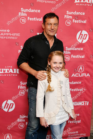 "Actor Jason Isaacs, top, and actress Avery Phillips pose at the premiere of ""Stolkholm, Pennsylvania"" during the 2015 Sundance Film Festival, in Park City, Utah"