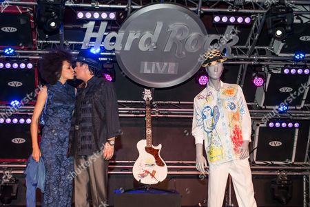 Cindy Blackman Santana and Carlos Santana share a kiss at an intimate meet and greet held at Hard Rock Cafe Las Vegas Strip on . Rock legend Carlos Santana generously donated several pieces of clothing from his personal collection, as well as PRS Carlos Santana Abraxas guitar, to join the world-famous Hard Rock Memorabilia Collection