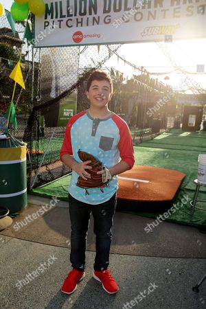 """Bradley Steven Perry at Disney's """"Million Dollar Arm"""" Pitching Contest at Downtown Disney, in Anaheim, CA. Walt Disney Pictures holds the first day of try outs in the Million Dollar Arm Pitching Contest. Contestants have a chance to win a trip to the Hollywood Premiere of the new movie MILLION DOLLAR ARM where the finalists will compete to win a million dollars. Starring Jon Hamm, MILLION DOLLAR ARM is the incredible true story of two young men who went from never throwing a baseball to being given a shot in Major League Baseball. The film opens nationwide on May 16"""