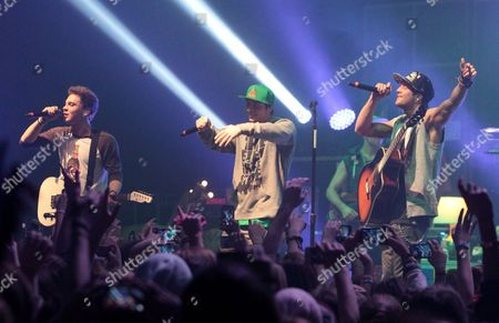 Keaton Stromberg, from left, Drew Chadwick, and Wesley Stromberg of the pop rock band Emblem3 perform in concert during the group's Band Life Tour at the Fillmore, in Silver Spring, Md
