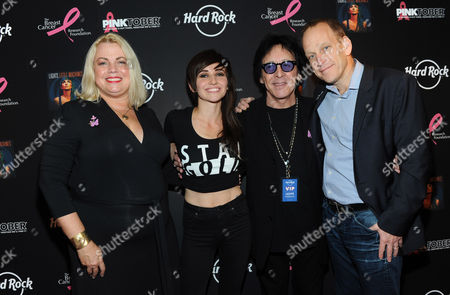 Canadian electro-pop singer Lights, center left, founding member of KISS Peter Criss, center right, Stephanie Kauffman, of Breast Cancer Research Foundation, and John Galloway, Chief Marketing Officer, Hard Rock International, pose on the PINK carpet at Hard Rock Cafe New York to launch PINKTOBER, Hard Rock's 15th annual breast cancer awareness campaign