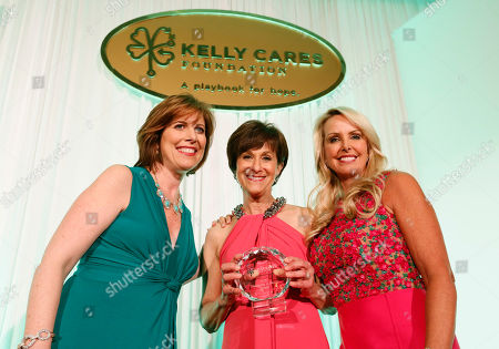 Myra Biblowit, president of the Breast Cancer Research Foundation, center, receives the Leadership in Health Award from Boston's WCVB television, Kelley Tuthill, left, and Director of the Bill Belichick Foundation, Linda Holliday, right, at the Kelly Cares Foundation's 5th Annual Irish Eyes Gala at the JW Marriot Essex House, on in New York. Established in 2008 by Notre Dame head football coach Brian Kelly and Paqui Kelly, the Kelly Cares Foundation has donated over $2 million to support causes locally, nationally and globally