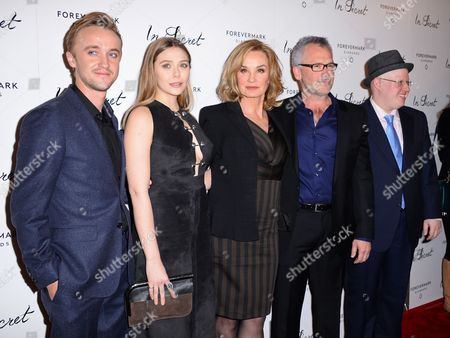 "Tom Felton and from left, Elizabeth Olsen, Jessica Lange, Charlie Stratton and Matt Lucas arrive at the Los Angeles premiere of ""In Secret"" at ArcLight Cinemas Hollywood on"