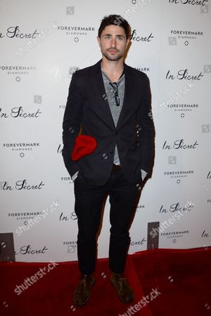 """Stock Image of Matt Dallas arrives at the Los Angeles premiere of """"In Secret"""" at ArcLight Cinemas Hollywood on"""