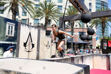 Kacy Catanzaro runs the parkour course at Ubisoft's Assassin's Creed Experience during Comic-Con on Thurs., in San Diego. The Assassin's Creed Experience is open to the public through Sun. July 27th