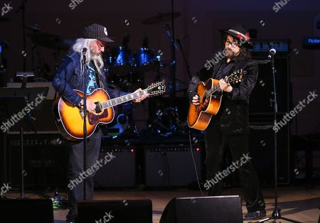 Stock Picture of Musicians J Mascis, left, and Sean Lennon perform together at The Music of David Bowie tribute concert at Carnegie Hall on Thursday, March, 31, 2016, in New York