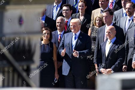 Donald Trump, Dina Powell, Deputy National Security Advisor for Strategy and H.R. McMaster, National Security Advisor
