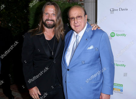 Max Martin, Clive Davis. Max Martin, left, and Clive Davis arrive at the 13th Annual Songs of Hope, in Los Angeles