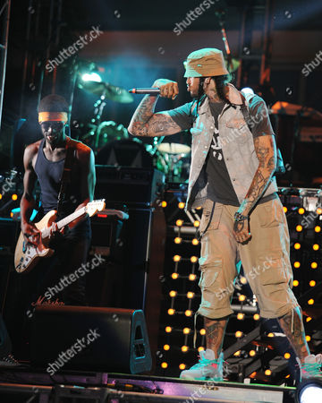 JUNE 30: Disashi Lumumba-Kasongo and Travie McCoy of Gym Class Heroes perform at the IHeartRadio concert at Fontainebleau Miami Beach on in Miami Beach, Florida