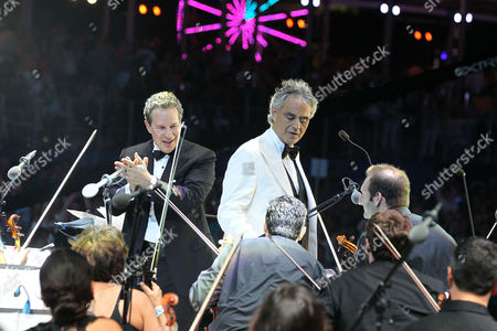 International singer and songwriter Andrea Bocelli (right), with conductor Eugene Kohn (left), perform on the beach at the Hard Rock Rising Miami Beach global music festival, in Miami Beach
