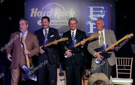 Jim Allen, Chairman of Hard Rock International, left, Eugene J. Cassidy, CEO of Eastern States Exposition, Donald R. Chase, Chairman of Eastern States Exposition, and Hamish Dodds, right, CEO of Hard Rock International, celebrate the announcement of Hard Rock International's application submission for Hard Rock Hotel & Casino New England at Eastern States Exposition by presenting custom guitars on in West Springfield