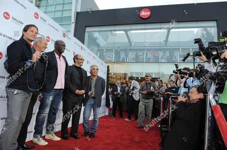 From left, Leica Director of Sales Steffen Keil, Leica Chief Executive Officer Alfred Schopf, Musician Seal, Leica Deputy Chairmain of the Supervisory Board Dr. Andreas Kaufmann, and photographer Nick Ut arrive at the Leica Store Los Angeles Grand Opening on in Los Angeles