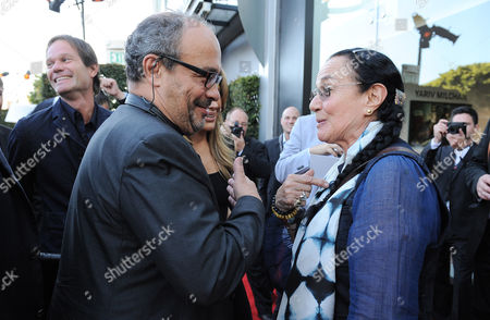 Dr. Andreas Kaufmann, left, and Mary Ellen Mark arrive at the Leica Store Los Angeles Grand Opening on in Los Angeles