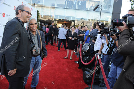 Dr. Andreas Kaufmann, left, and photographer Nick Ut arrive at the Leica Store Los Angeles Grand Opening on in Los Angeles