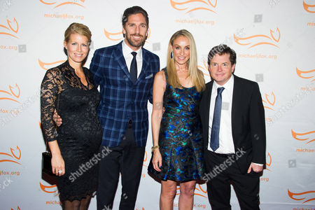 """Therese Andersson, left, Henrik Lundqvist, Tracy Pollan and Michael J. Fox attend The Michael J. Fox Foundation for Parkinson's Research benefit, """"A Funny Thing Happened on the Way to Cure Parkinson's,"""" at the Waldorf Astoria, in New York"""