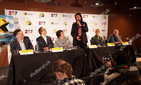 David Bishop of NAMCO USA INC., Professor Toru Iwatani, PAC-MAN lead creator with interpreter, Video game record holder, Billy Mitchell, Marco Mah of BANDAI NAMCO Entertainment America and Ben Acevedo of BANDAI NAMCO Entertainment America seen at the PAC-MAN's Official 35th Birthday Celebration at LEVEL 257 on in Schaumburg, IL