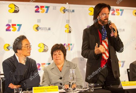 Professor Toru Iwatani, PAC-MAN lead creator with interpreter and video game record holder, Billy Mitchell seen at the PAC-MAN's Official 35th Birthday Celebration at LEVEL 257 on in Schaumburg, IL