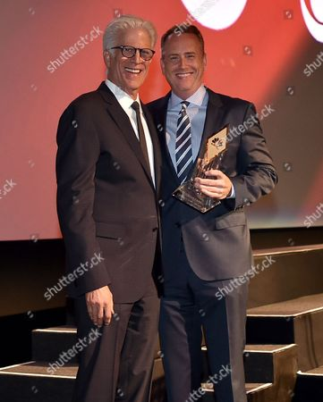 Ted Danson, left, presents NBCUniversal's Robert Greenblatt with the Hall of Fame Cornerstone Award at the Television Academy's 70th Anniversary Gala and Opening Celebration for its new Saban Media Center, in the NoHo Arts District in Los Angeles