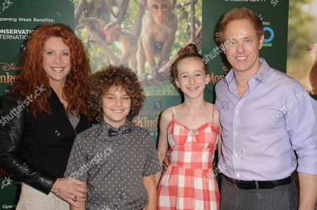 """Actress Lisa Akey, from left, Django Sbarge, Gracie Sbarge, and actor Raphael Sbarge arrive at the World Premiere Of """"Monkey Kingdom"""" held at Pacific Theatres at The Grove, in Los Angeles"""