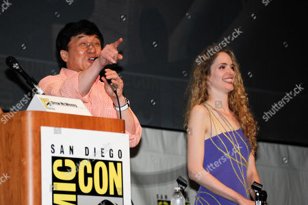 Actor Jackie Chan, left, speaks next to actor Laura Weissbecker during a panel at the Comic-Con convention held at the San Diego Convention Center, in San Diego
