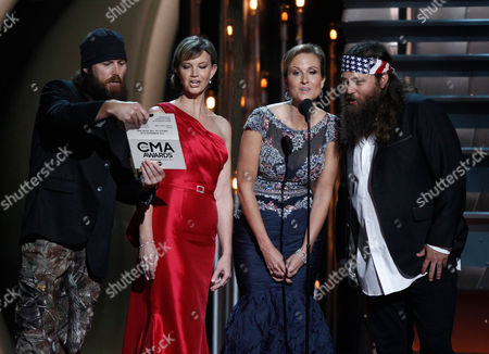 Duck Dynasty members, from left, Jase Robertson, Missy Robertson, Korie Robertson and Willie Robertson speak onstage at the 47th annual CMA Awards at Bridgestone Arena, in Nashville, Tenn