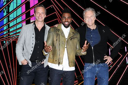 Stock Image of Tom Poleman President of National Programming Platforms for Clear Channel, from left, Jason Derulo and Clear Channel Radio President of Entertainment Enterprises John Sykes attend the 2016 iHeartRadio Music Awards press preview day, in Inglewood, Calif