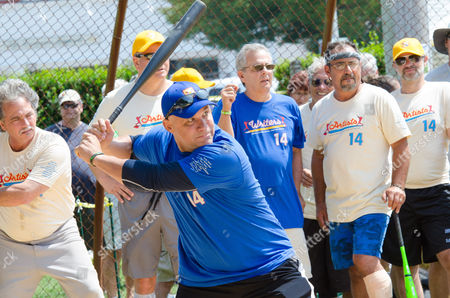 Stock Photo of Jim Leyritz bats at the 66th Annual Artists and Writers Softball Game in East Hampton on in New York